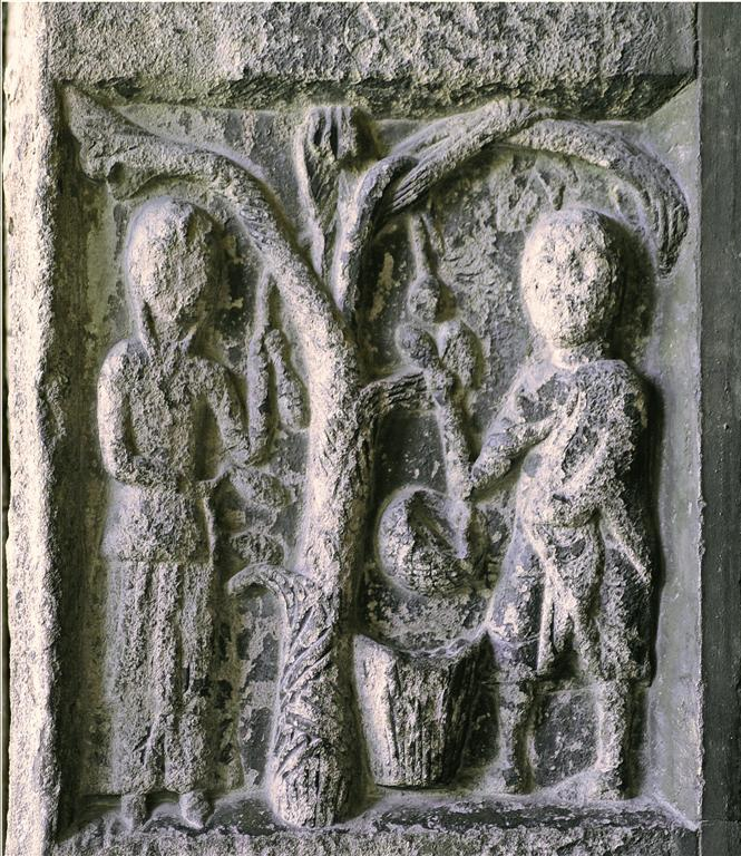 Setembre: un home i una dona veremant al calendari de la portada romànica de Ripoll